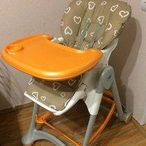 Оранжевый столик на стульчике для кормления cam